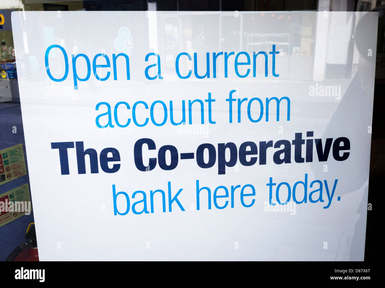 Co-op banking poster in a bank window - Stock Image