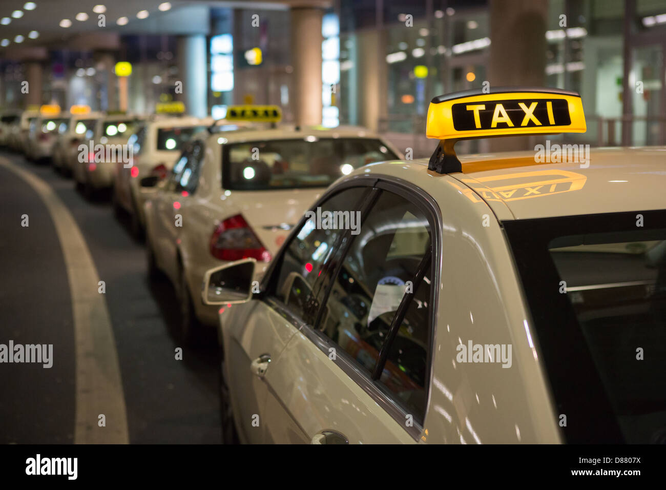 Taxis wait at night outside Dusseldorf Airport Stock Photo