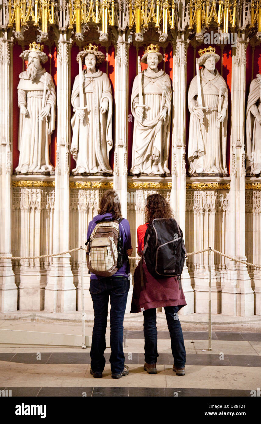 Two teenagers in York Minster cathedral, - concept of teens and Christian religion christianity  UK - Stock Image