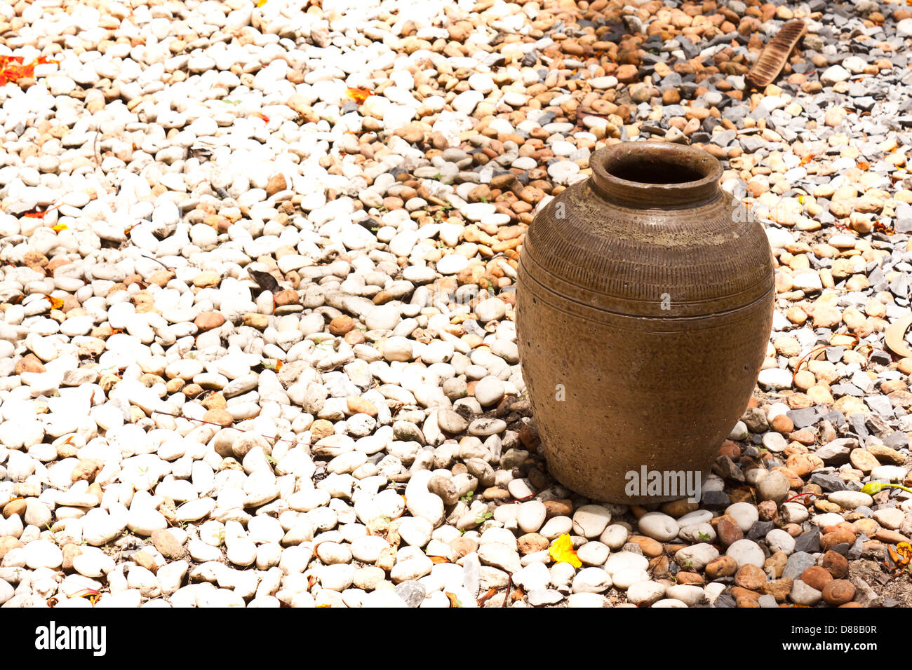 jar on a small white stone - Stock Image