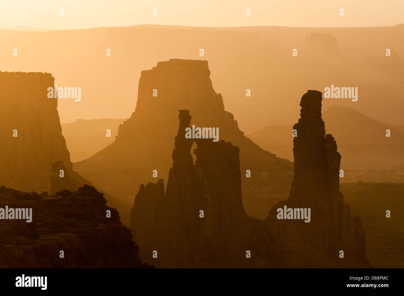 Rock spires and mesas recede into the distance as seen at Canyonlands National Park, Utah shortly after sunrise. Stock Photo