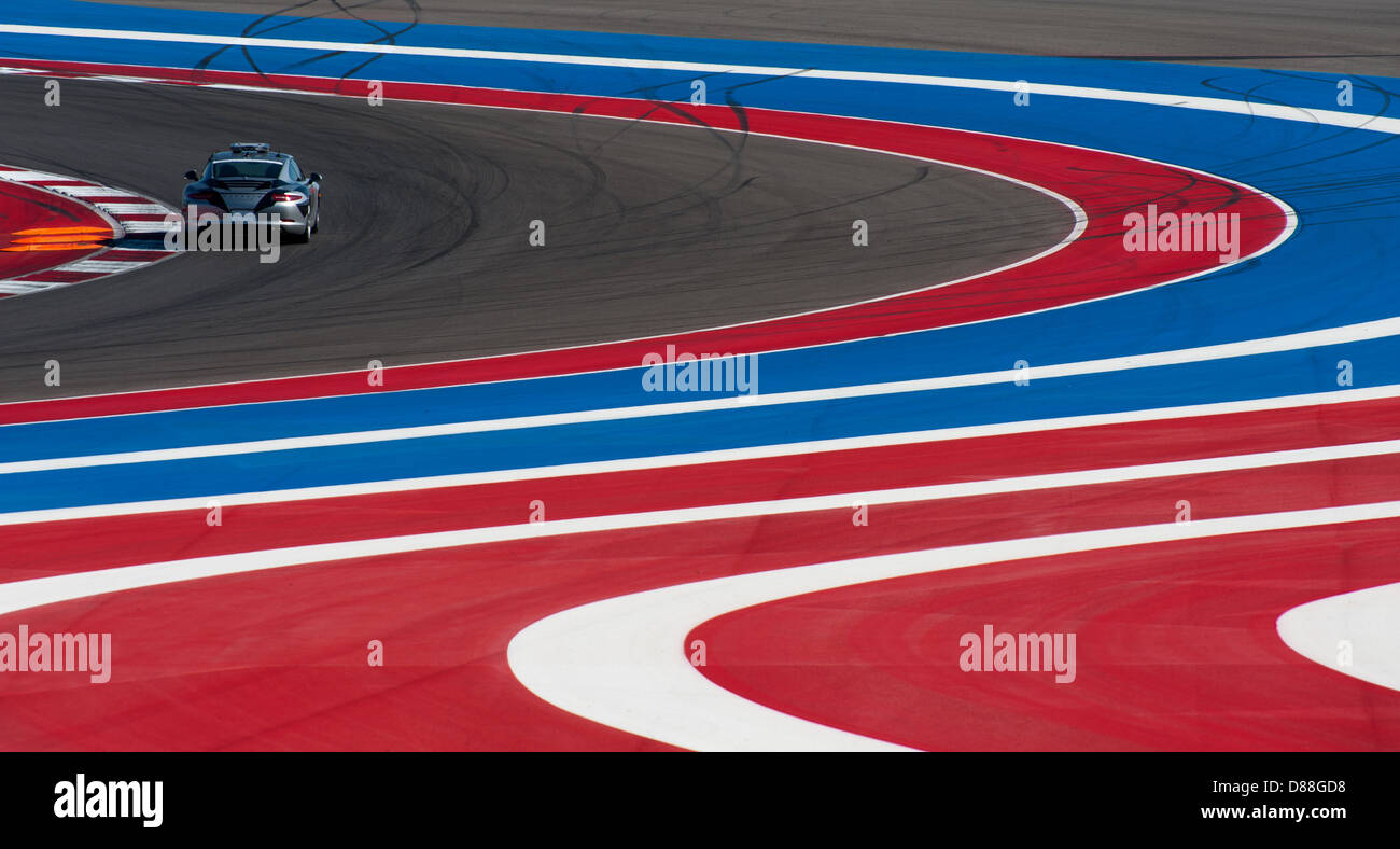 The safety car negotiates the S-curves at Circuit of the Americas, Austin, TX during Grand-Am racing, March 2013. - Stock Image