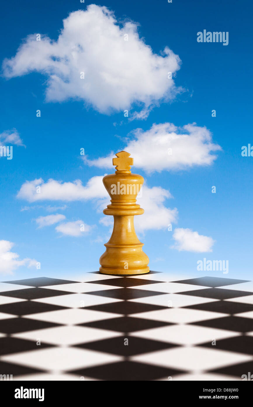 Chess - Fresh New Strategy - chess king on black and white board in front of blue skty. Concepts of fresh strategy... - Stock Image