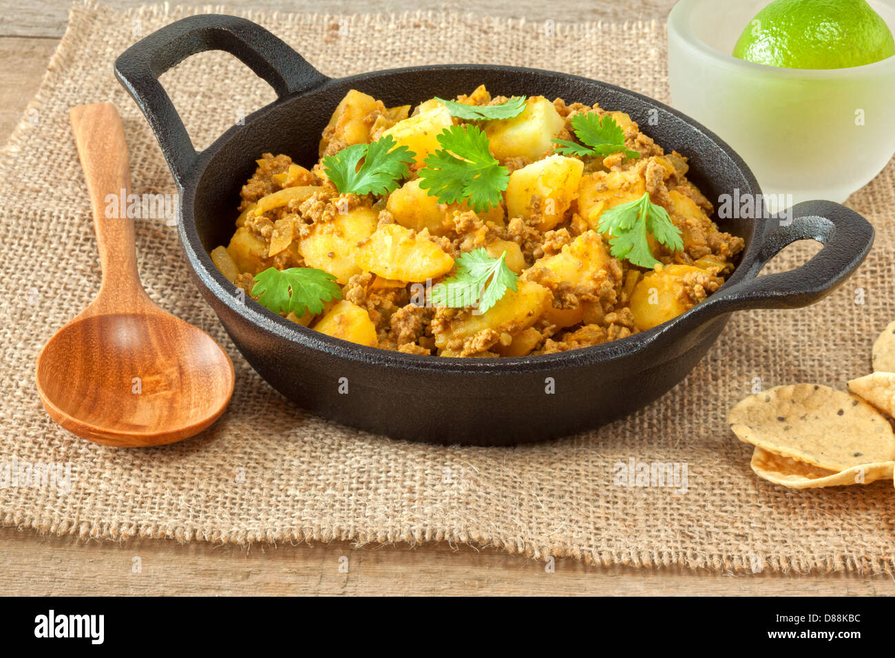 Beef and Potato Curry - a healthy low calorie meal of lean minced or ground beef in a curry with potatoes and coriander... - Stock Image