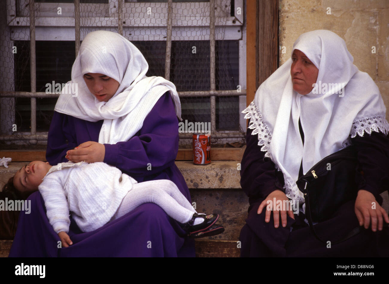 Palestinian women waiting to visit relatives being held at a police detention house   in West Jerusalem Israel - Stock Image