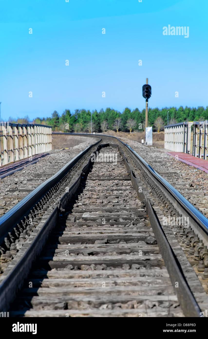 Empty railroad track with semaphore signal Stock Photo