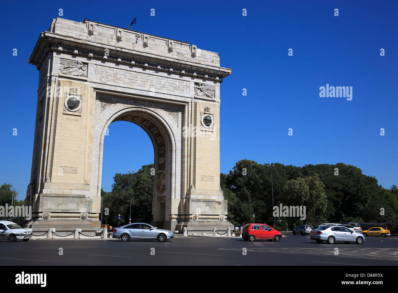 Arcul de Triumf is a triumphal arch located in the northern part of Bucharest, on the Kiseleff Road Stock Photo