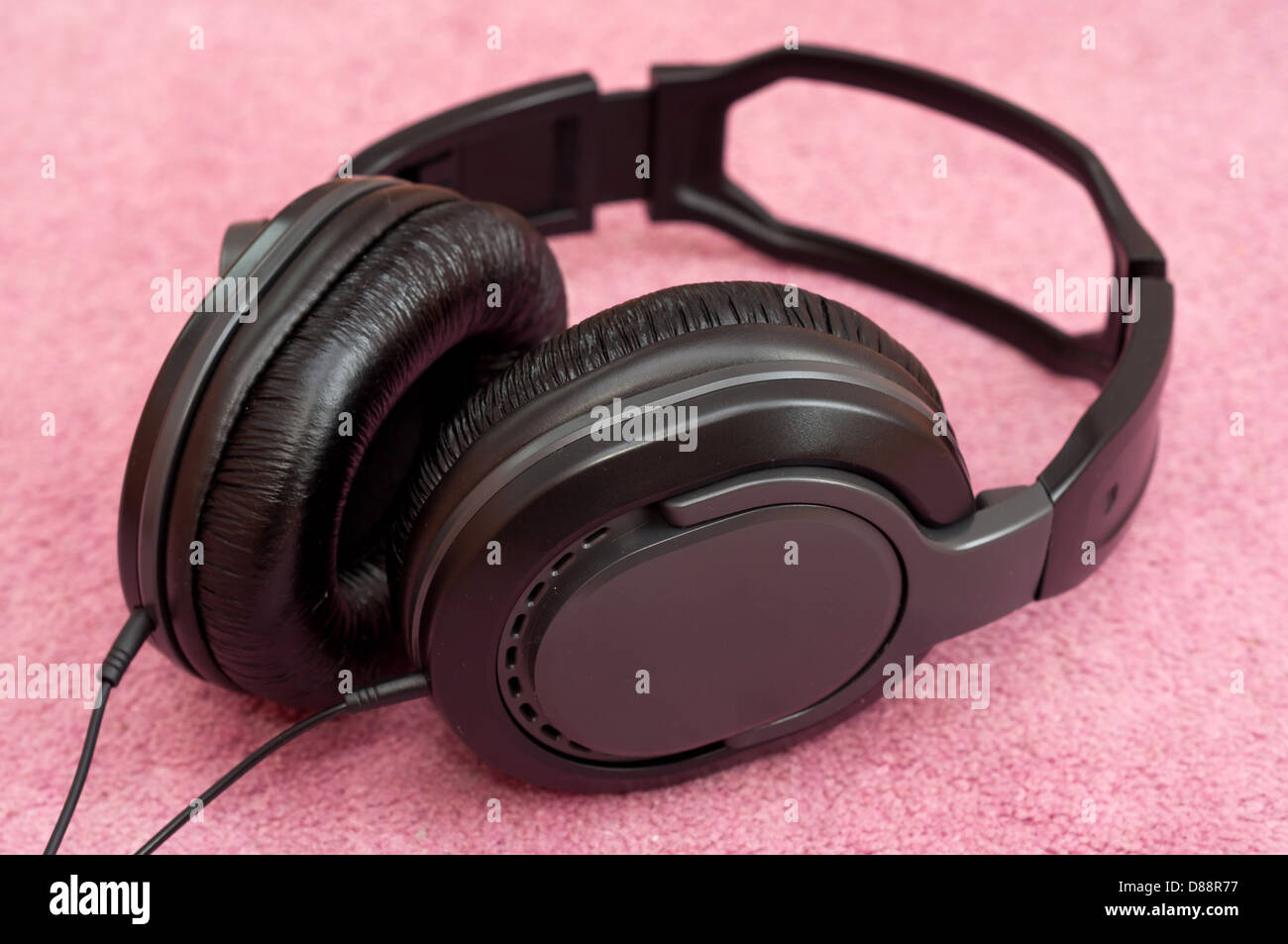 Stereo Headphones on colour background Stock Photo
