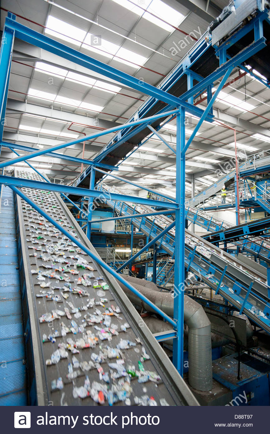 Plastic on conveyor belt in recycling plant - Stock Image
