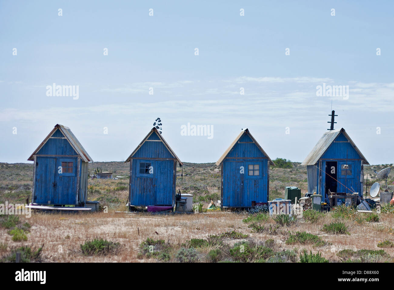 Blue painted beach huts on a desert island in Portugal - Stock Image