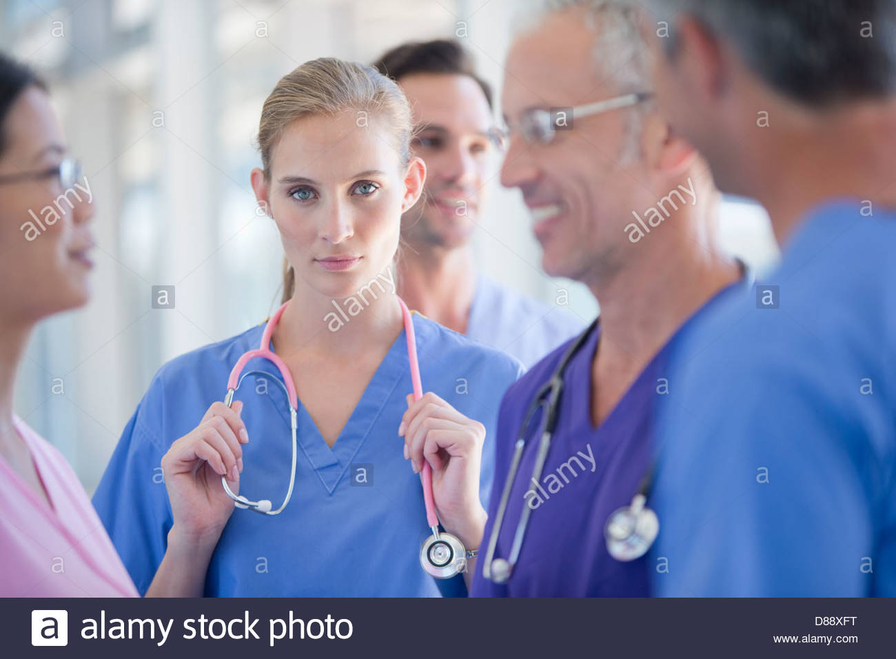 Portrait of serious doctor among co-workers Stock Photo