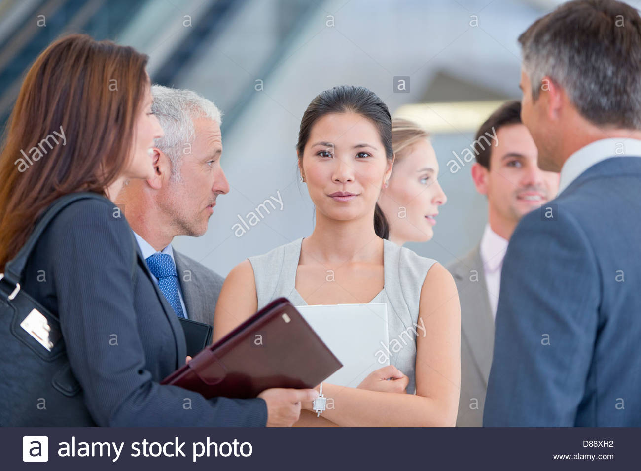 Portrait of confident businesswoman among co-workers - Stock Image