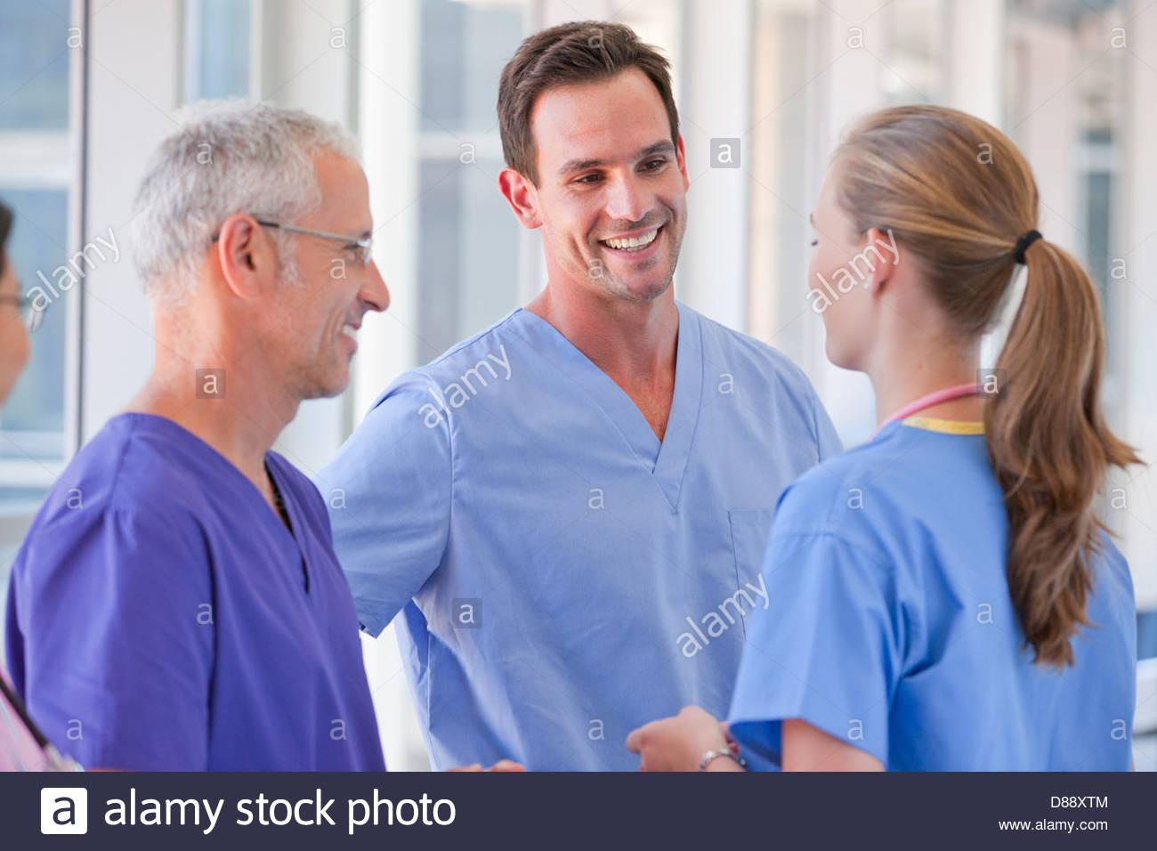 Smiling doctors talking - Stock Image