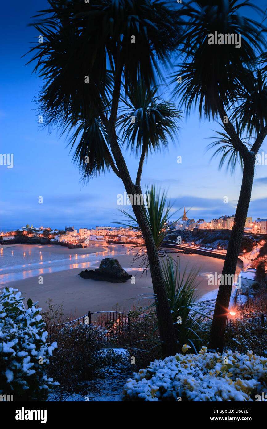 Winter snow at Tenby Harbour Tenby Pembrokeshire Wales at twilight - Stock Image