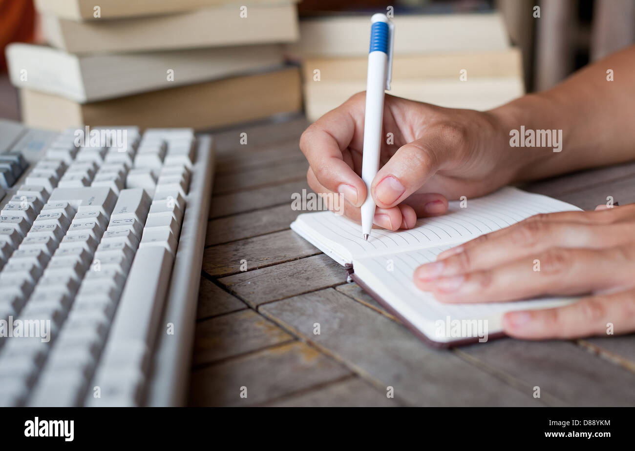 abstract hands writing in notepad, education - Stock Image