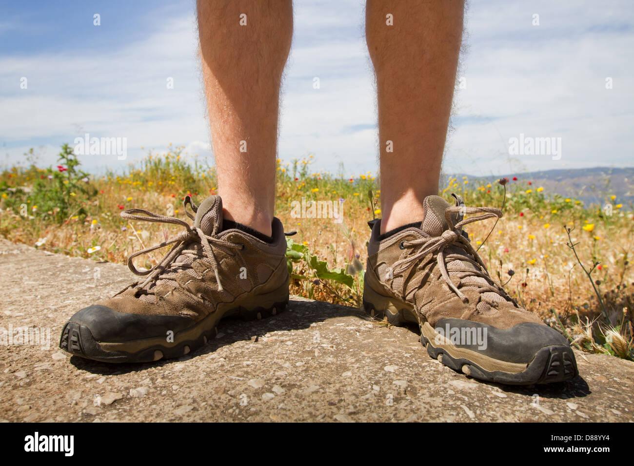 trekking shoes outdoor, legs of hiker - Stock Image