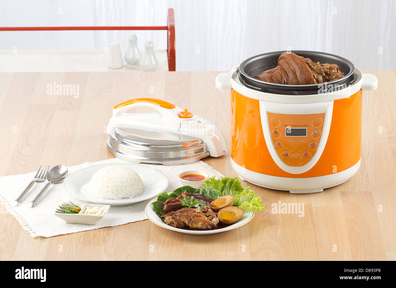 Electric pressure cooker new technology for cooking - Stock Image