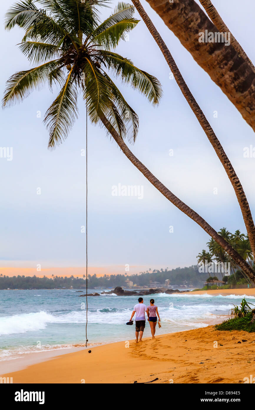 Couple walking on the beach in Sri Lanka Stock Photo