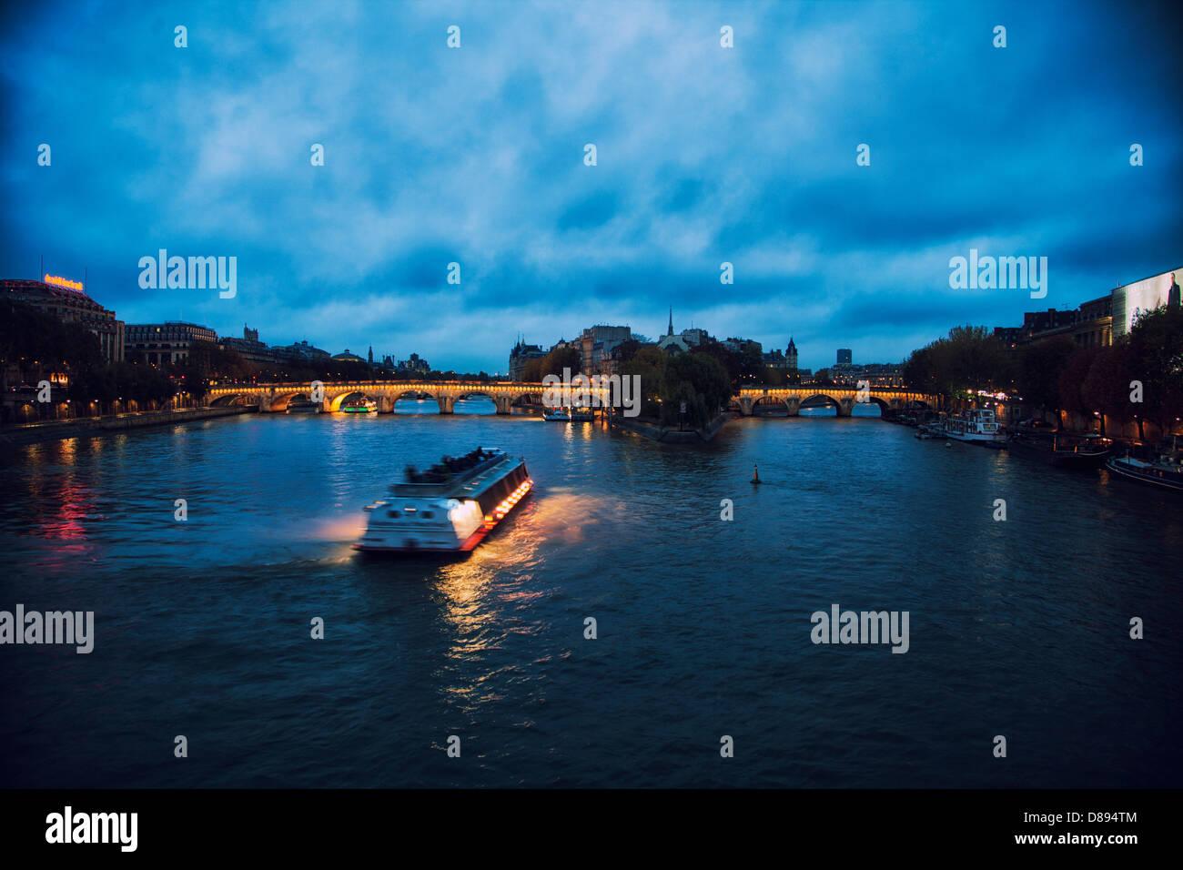 Romantic evening in Paris France. River Cruise, River Seine, Pont Neuf. - Stock Image