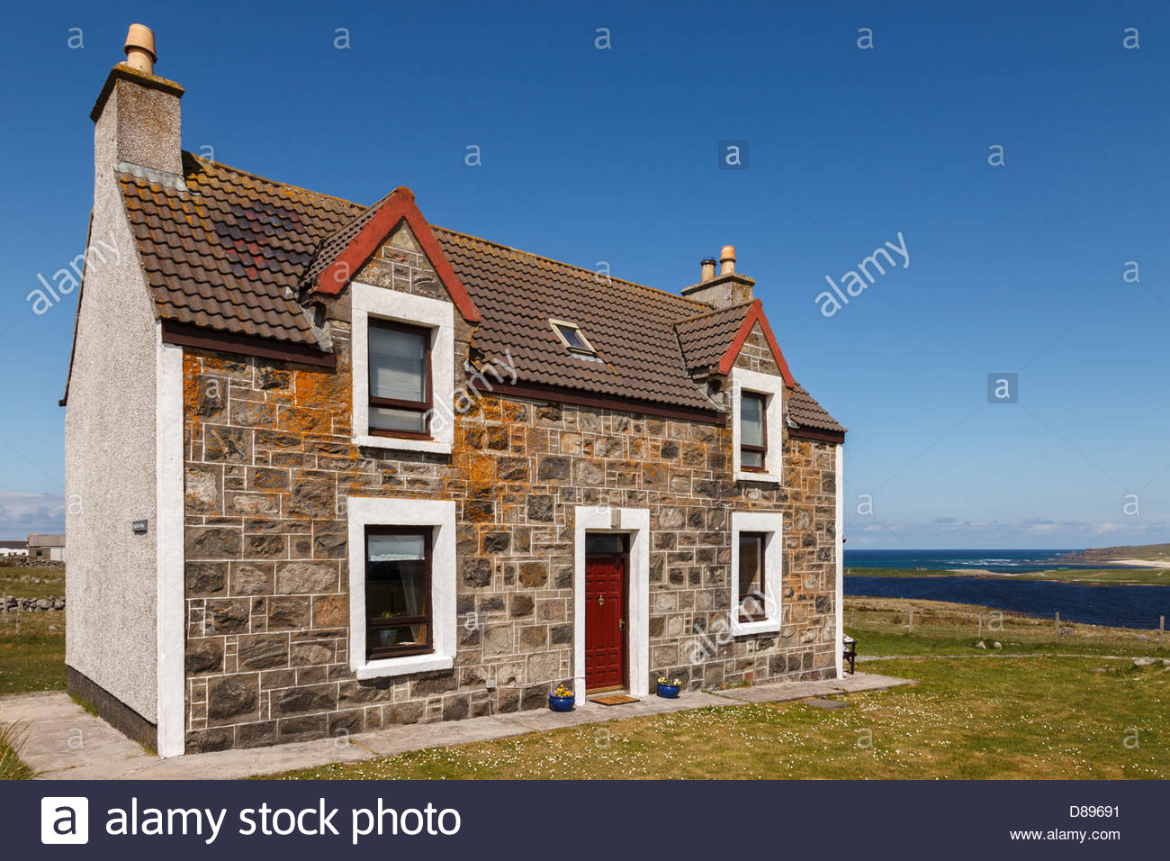 Oceanview (Sealladh na Mara), a traditional croft house in Brue, near Barvas, Isle of Lewis, Scotland - Stock Image