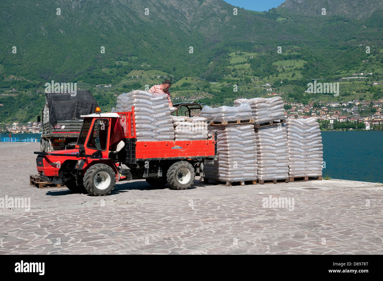 loading small truck with bags, monte isola, lake iseo, lombardy, italy - Stock Image