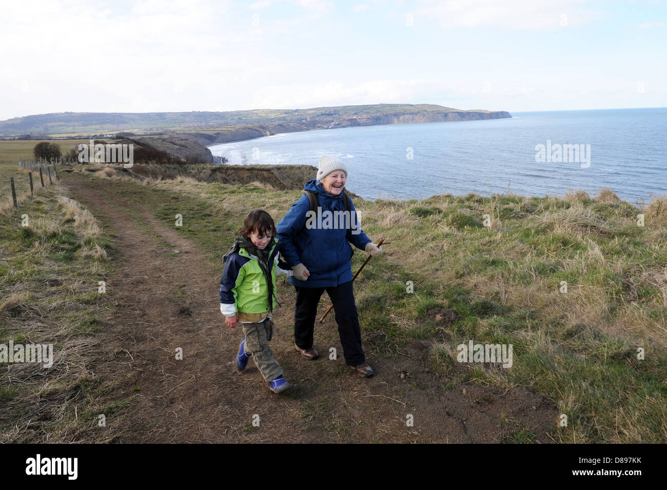 Grandparent and grandson rambling together on  part of the Cleveland way footpath, North Yorkshire, england , uk Stock Photo