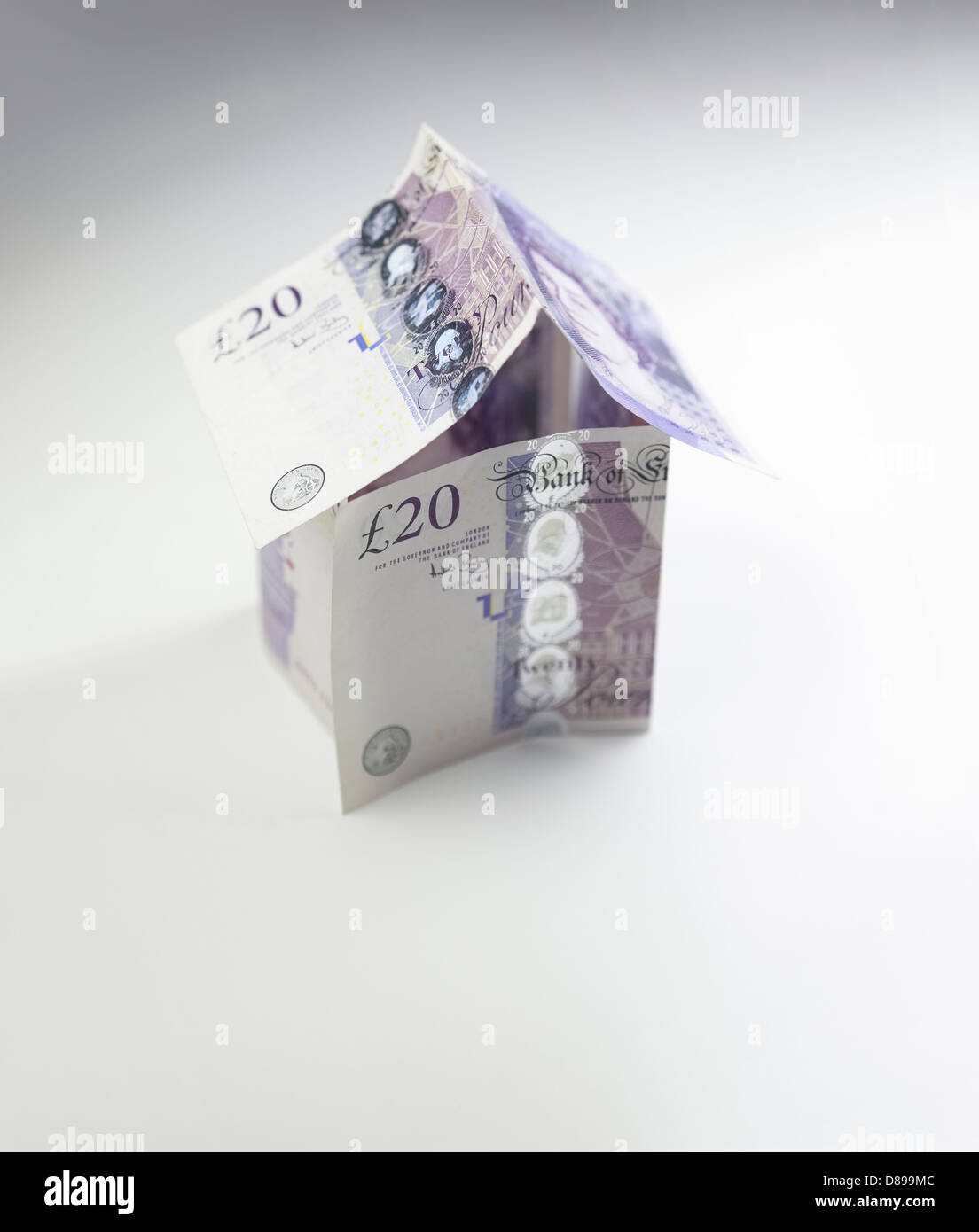 Property Investment. A house made of twenty pound notes. Stock Photo