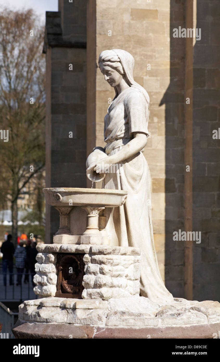 Sculpture of Roman water goddess Rebecca Fountain pouring water into a wash basin outside Bath Abbey, Bath, Somerset Stock Photo