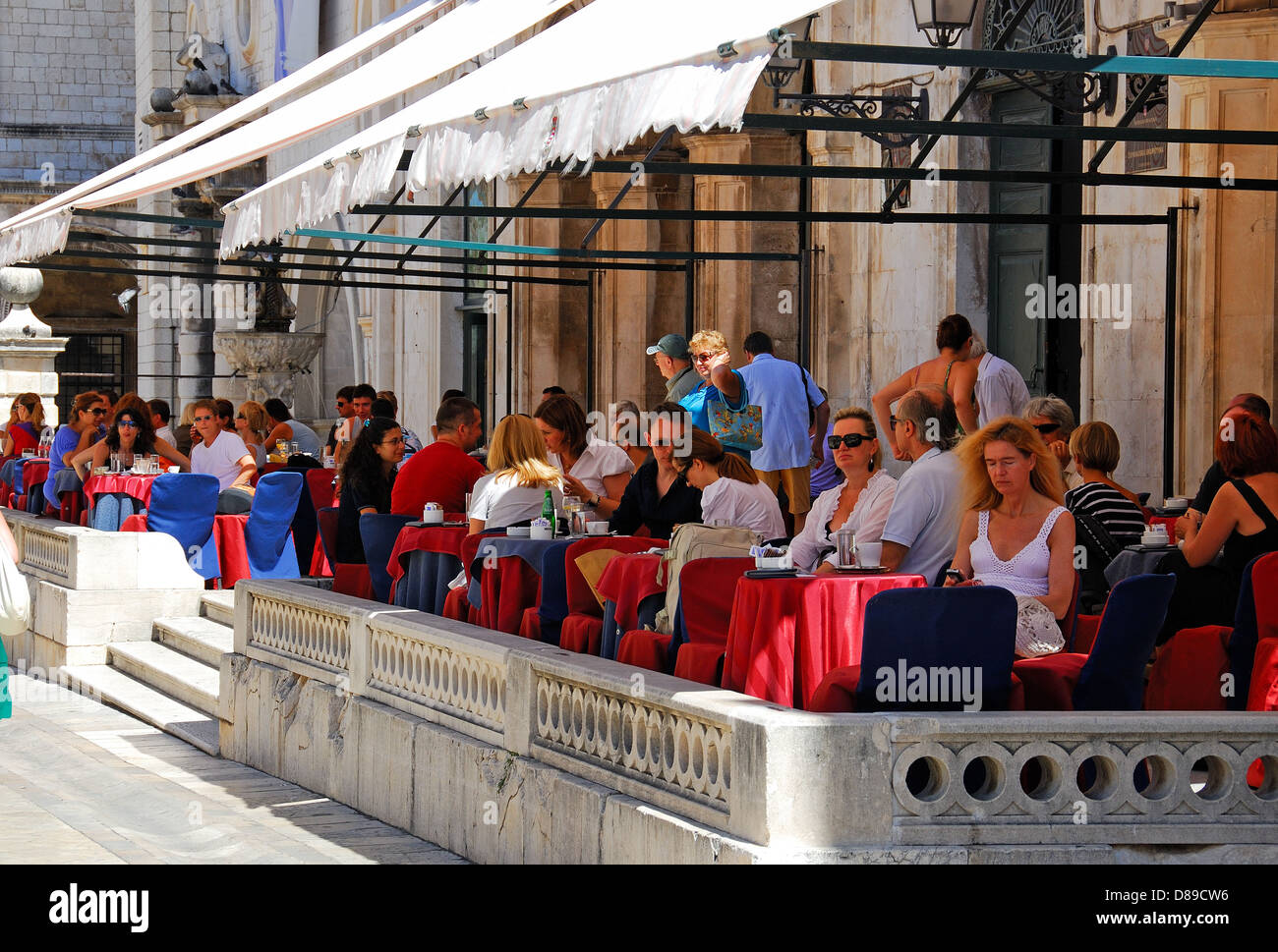 DUBROVNIK, CROATIA. A busy cafe terrace in the old walled town. Stock Photo