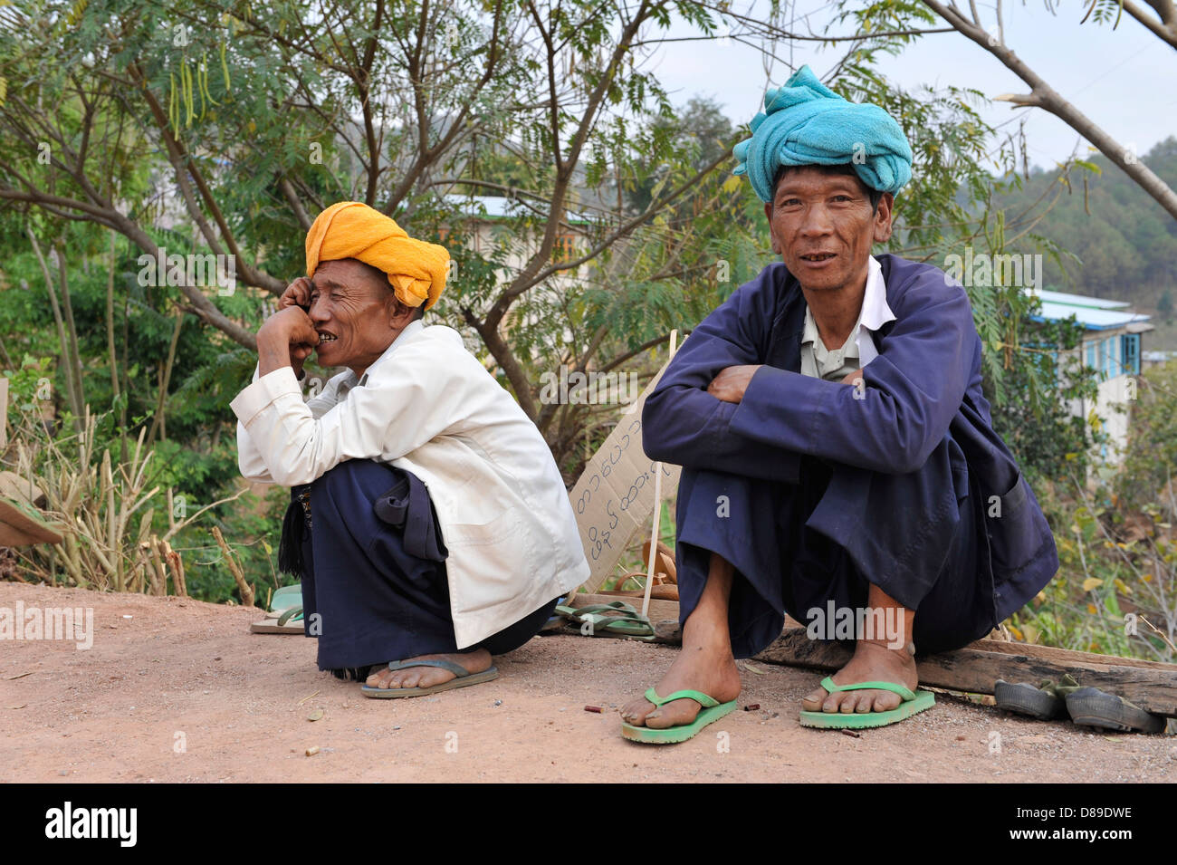 two Palaung men just relaxing - Stock Image