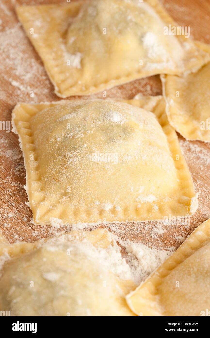 Fresh Homemade Ravioli against a back ground - Stock Image