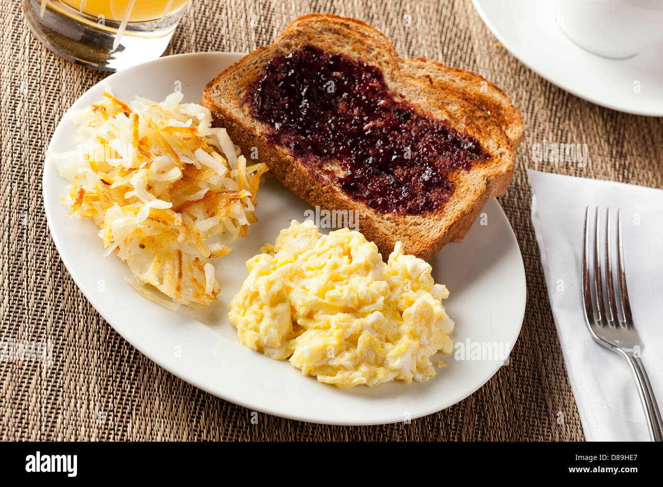 Homemade Wholesome American Breakfast with eggs, toast, and hashbrowns - Stock Image
