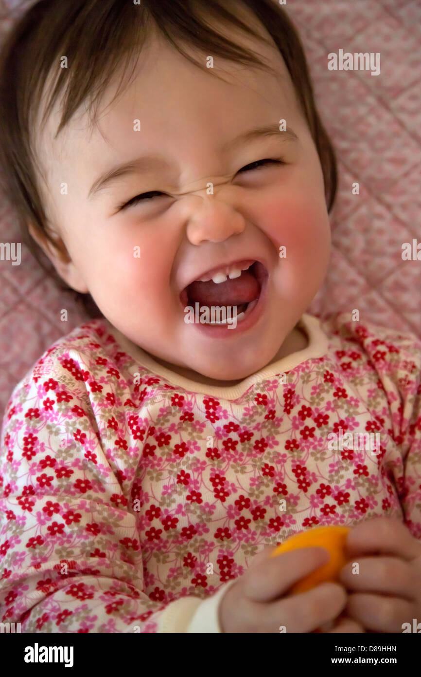 One year old girl making a funny face - Stock Image