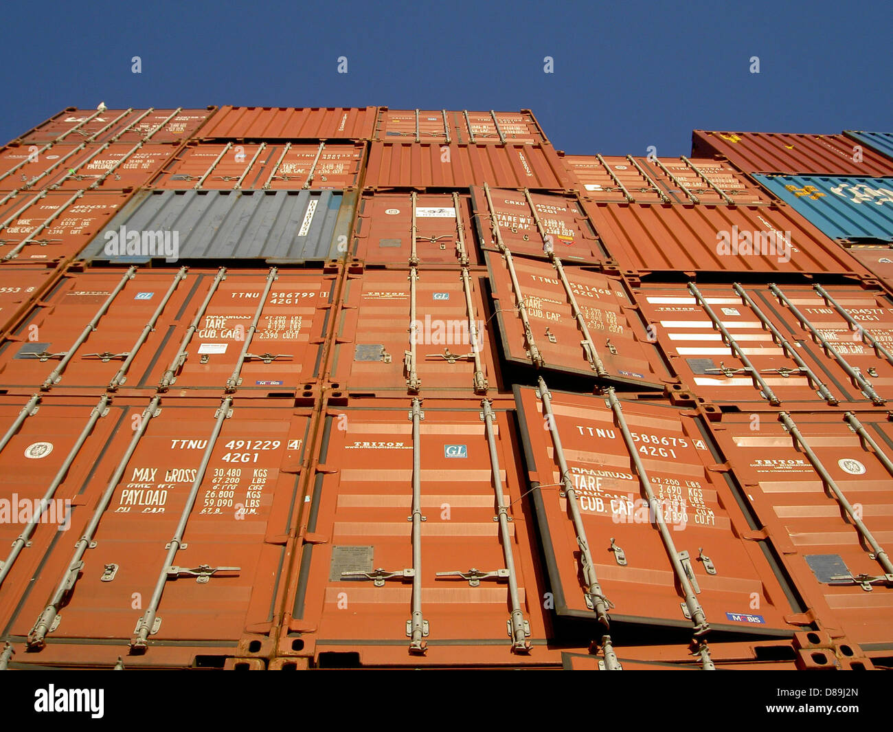 shipping containers crates metal steel stacked - Stock Image