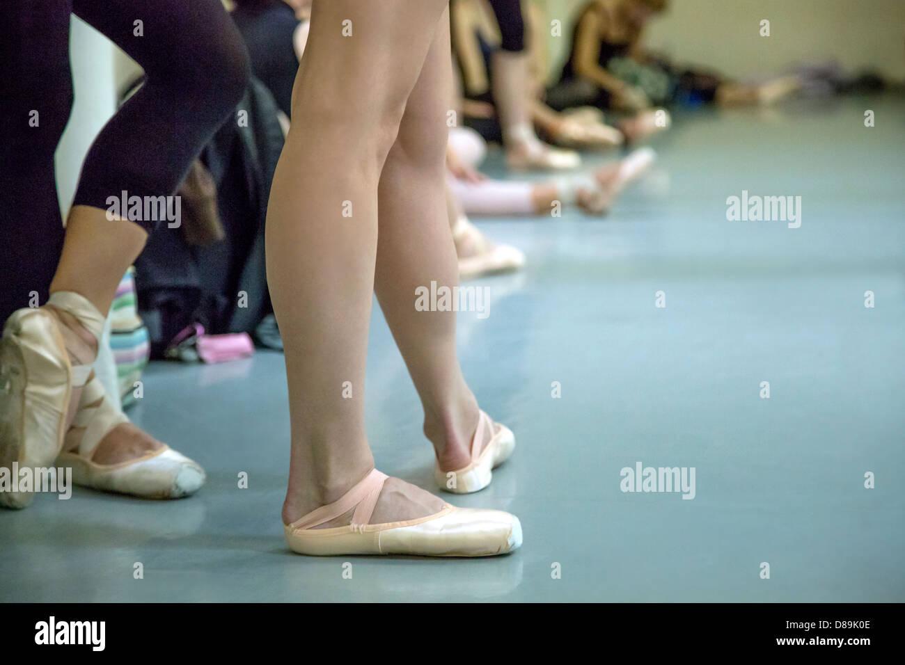Several ballet dancers inside the studio - Stock Image