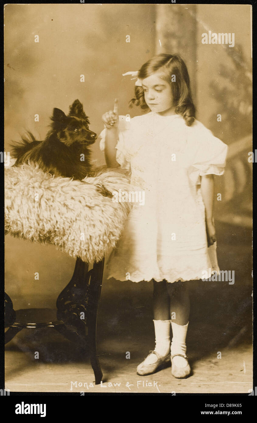 Little Girl And Pet Dog - Stock Image