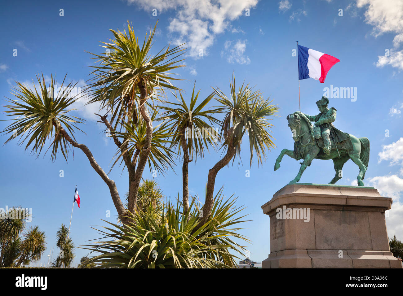Bronze equestrian statue, Napoléon Bonaparte with his first horse, Cherbourg, France, holding a French flag. - Stock Image
