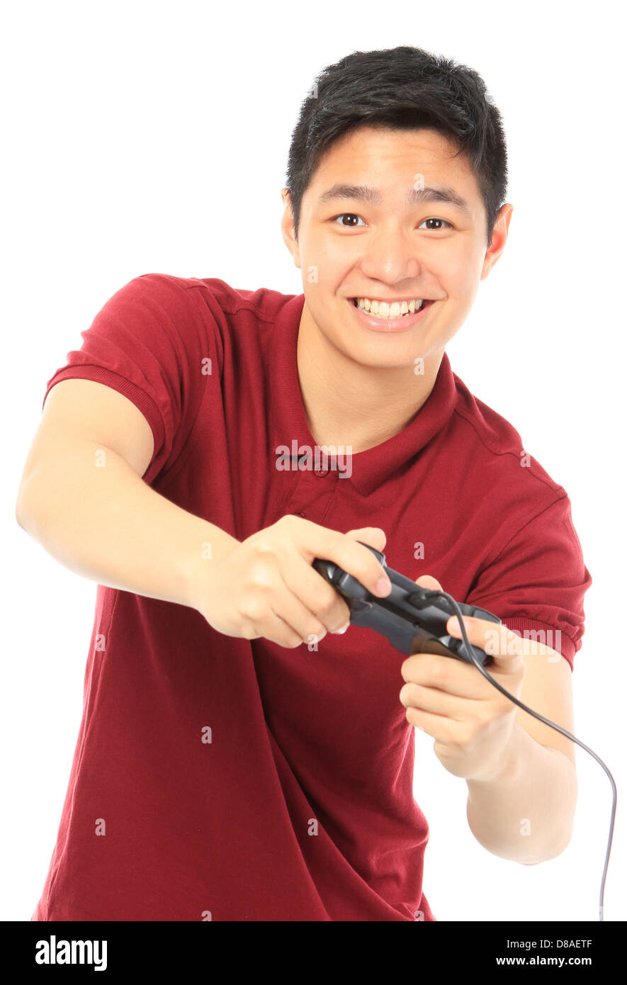 A teenager holding a game controller - Stock Image