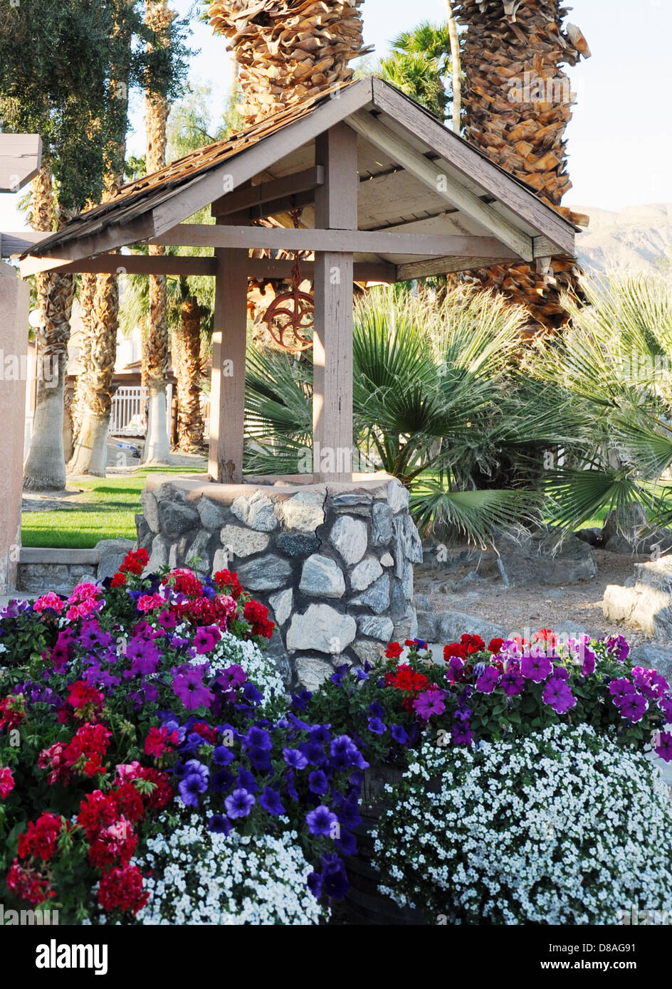 Flowers Surround Wishing Well In Desert Hot Springs California Stock