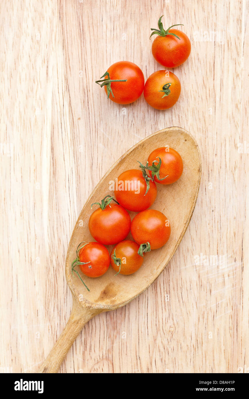 Mixed types of heritage tomatoes in styled shots. - Stock Image