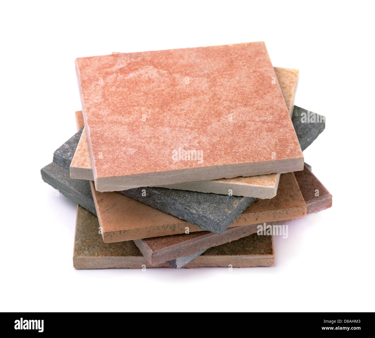 Stack of various stone tiles isolated on white - Stock Image
