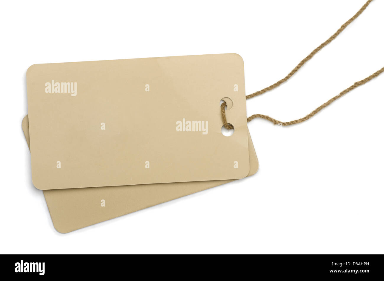 Two cardboard labels tied with brown string isolated on white - Stock Image
