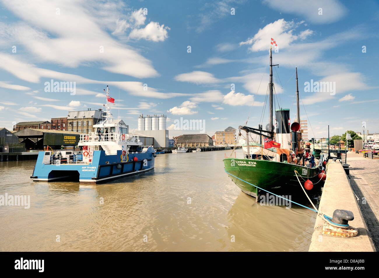 ASP Thames, new wind farm service craft, passes vintage steam herring drifter Lydia Eva. South Quay, Great Yarmouth, - Stock Image