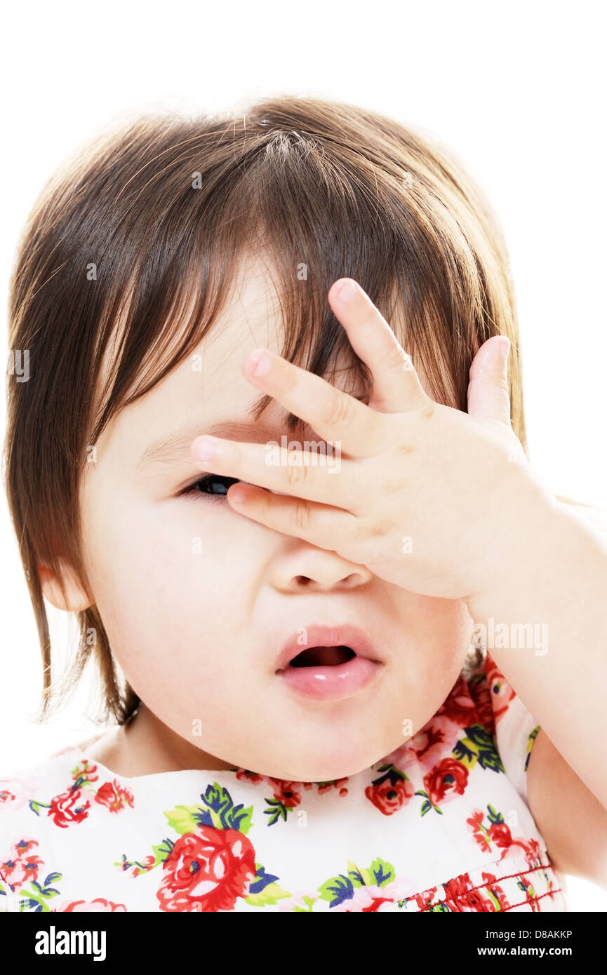 Little girl with hand on face closeup portrait - Stock Image