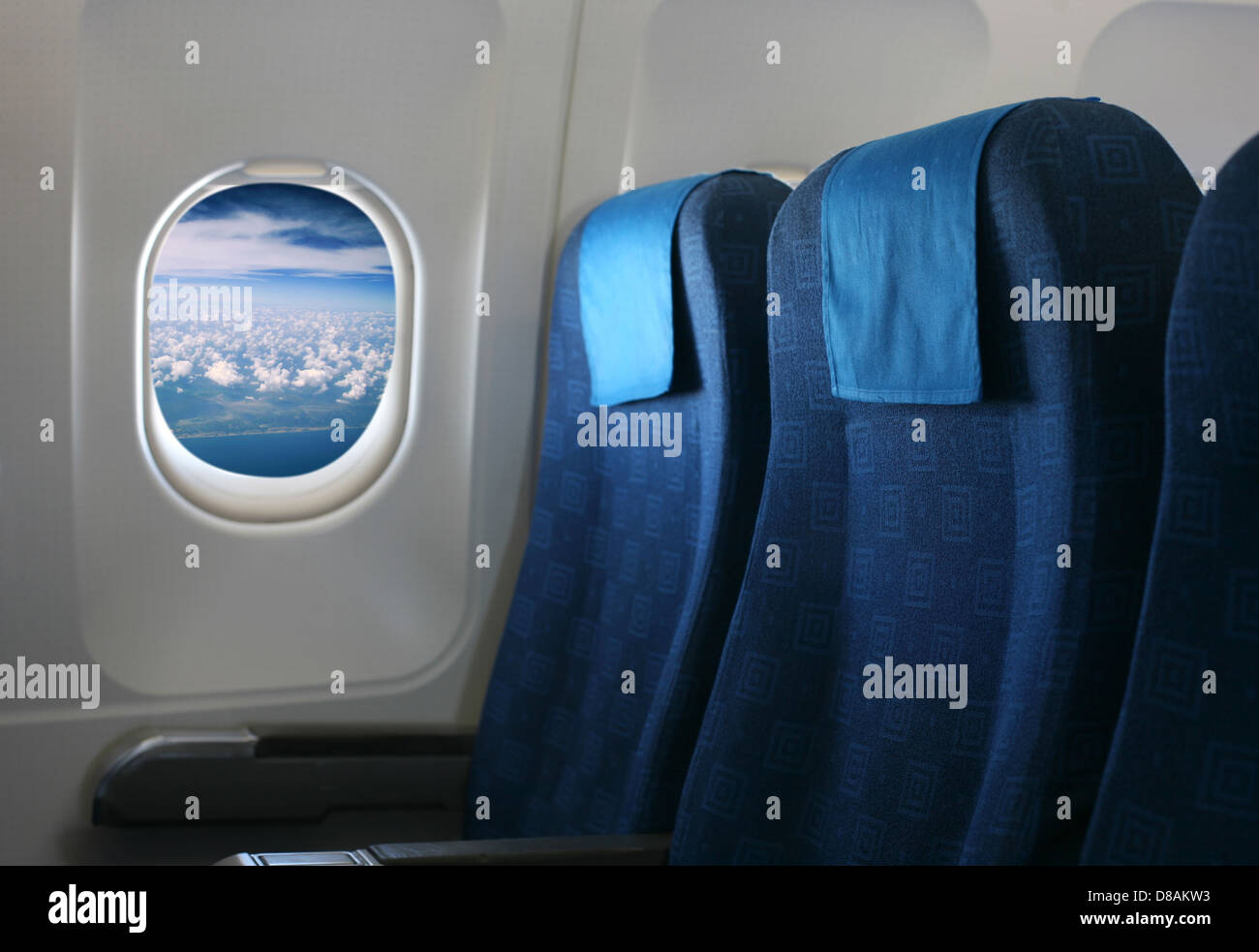 Airplane seat and window inside an aircraft - Stock Image