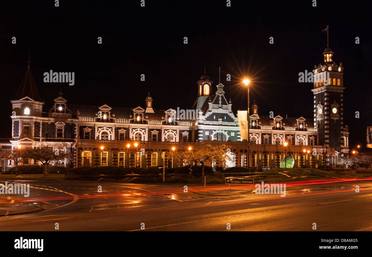 Dunedin Railway Station during RWC2011, including topiary rugby ball in front of station and motion blur of passing - Stock Image