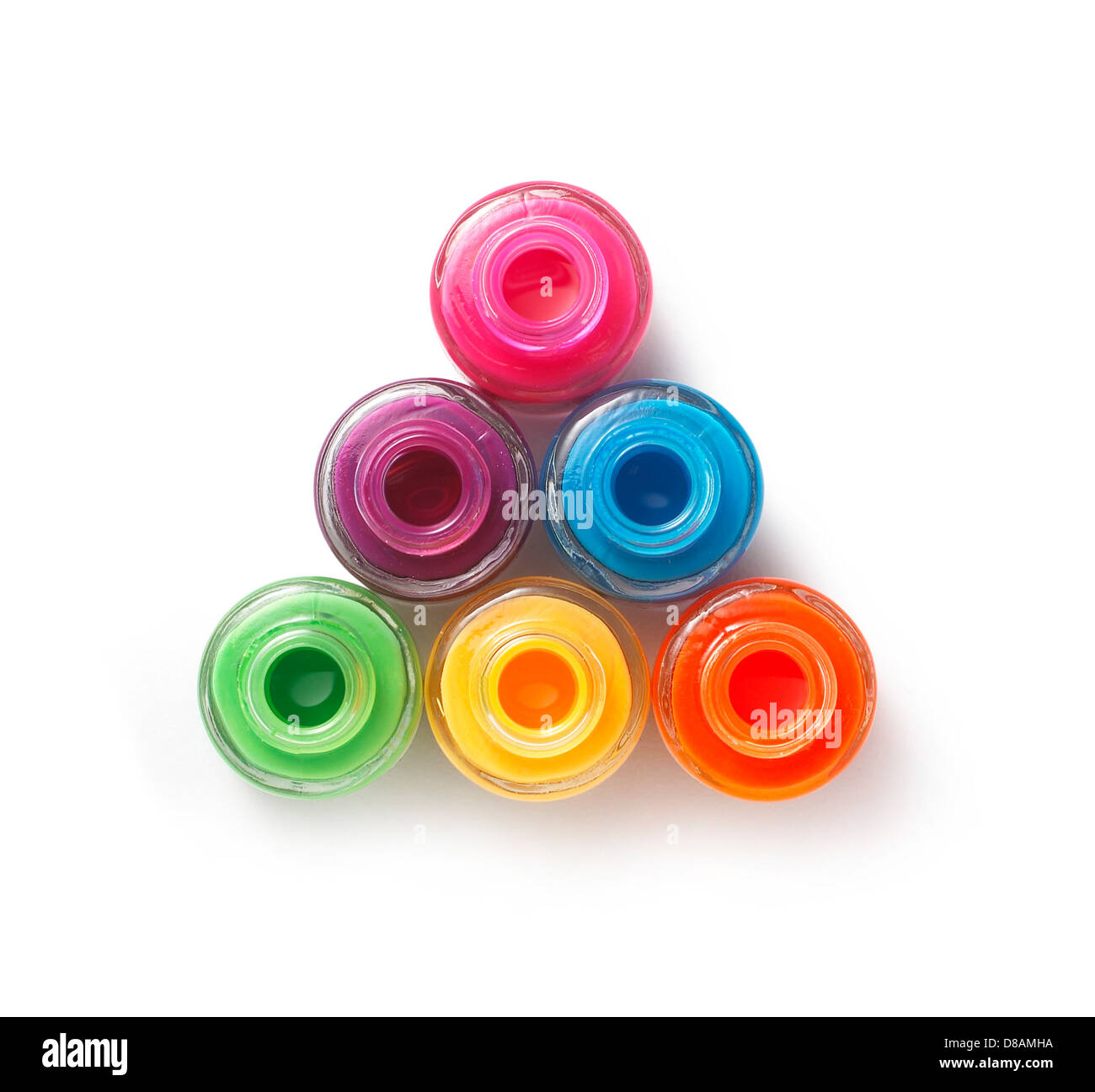 coloured nail polish pots cut out onto white background - Stock Image
