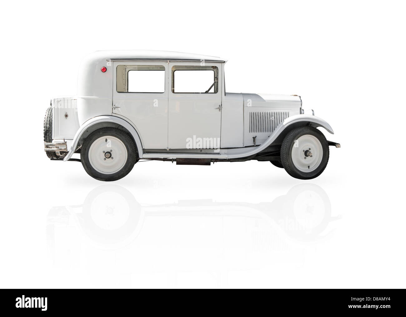 Side view of white retro car isolated on white background. Classic vintage model. Old and rare cars. Means of transport. - Stock Image