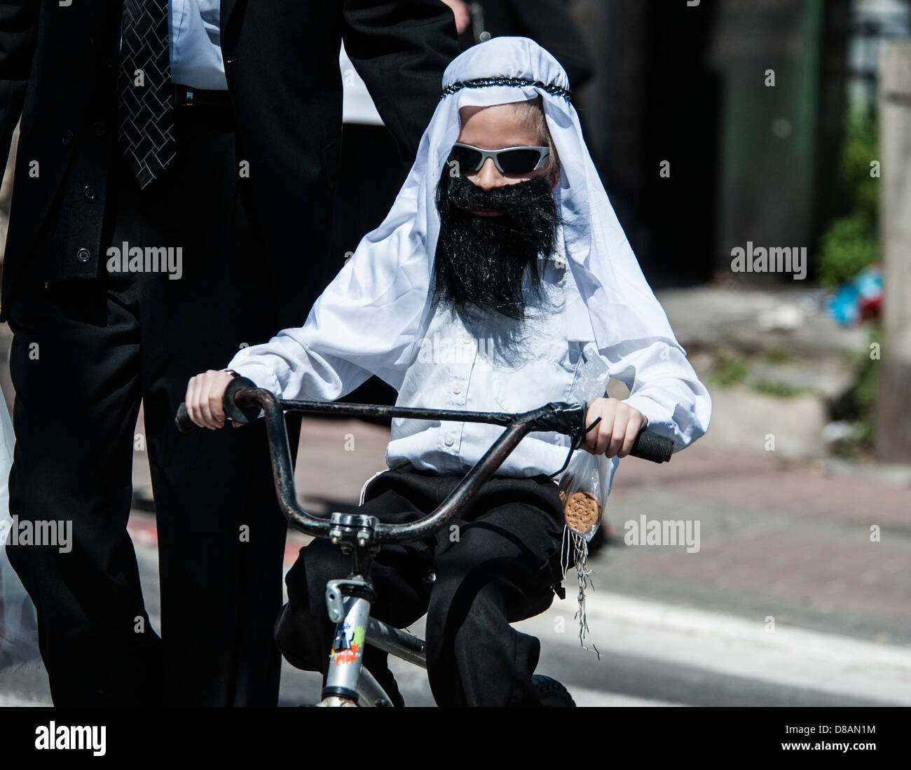 A young orthodox boy in Purim costume Photographed in Bnei Brak, Israel - Stock Image