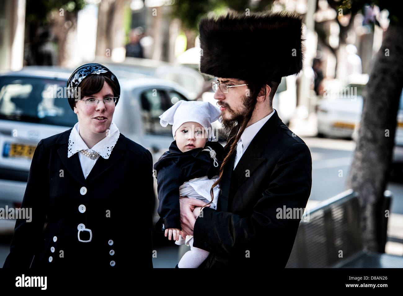 A Hassidic family in Purim costume Photographed in Bnei Brak, Israel - Stock Image